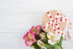 Gift Box with red star ribbon Stock Photo