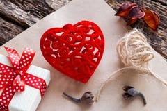 Gift box, red velvet heart on paper Royalty Free Stock Image