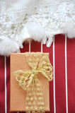 Gift Box on Red and White Stripe Background Stock Photos
