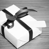 Gift box and ribbin with tag black and white color tone style Royalty Free Stock Image