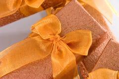 Gift box with ribbon. Closeup of orange gift box with ribbon royalty free stock photos
