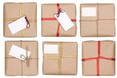 Gift box with ribbon and blank label Stock Photos