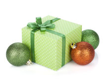 Gift box with ribbon and bow and christmas baubles Royalty Free Stock Images