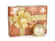 Gift box with ribbon, bow and christmas decor Stock Images