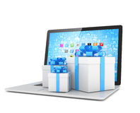 Gift box with ribbon bow on laptop Royalty Free Stock Images