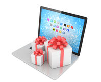 Gift box with ribbon bow on laptop Stock Photos