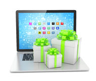 Gift box with ribbon bow on laptop Royalty Free Stock Photos