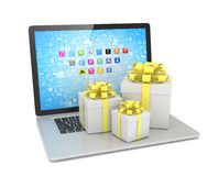 Gift box with ribbon bow on laptop Stock Photo