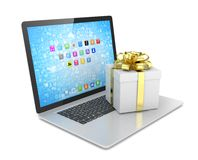 Gift box with ribbon bow on laptop Royalty Free Stock Photography