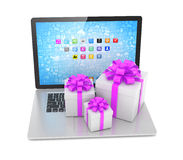 Gift box with ribbon bow on laptop Stock Image