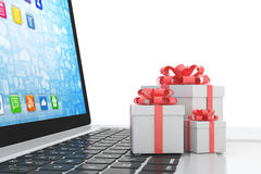 Gift box with ribbon bow on laptop Royalty Free Stock Photo