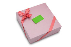 Gift box with ribbon bow and paper tag Royalty Free Stock Images