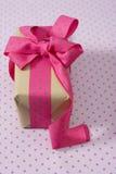 Gift box with ribbon and bow, pink and blue polka dot Royalty Free Stock Photo