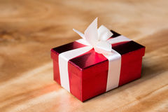Gift box with ribbon and bow. Present Stock Photos