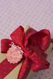 Gift box with ribbon and bow, red and blue polka dot Royalty Free Stock Image