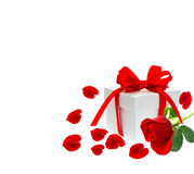 Gift box with ribbon bow. Red rose flower with petals Stock Photo