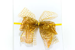 Gift box with ribbon and bow on white. White gift box with yellow ribbon and bow on white Royalty Free Stock Images