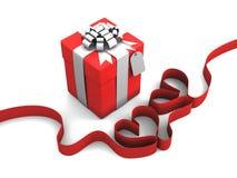 Gift box with Ribbon hearts Royalty Free Stock Photos