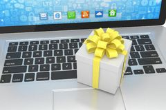 Gift box with ribbon on laptop Royalty Free Stock Images