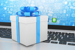 Gift box with ribbon on laptop Royalty Free Stock Photography