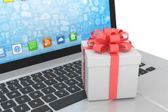 Gift box with ribbon on laptop Stock Photos
