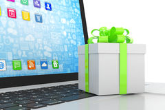 Gift box with ribbon on laptop Royalty Free Stock Photo