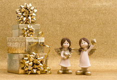 Gift box with ribbon and little angels. Holidays decoration Royalty Free Stock Images