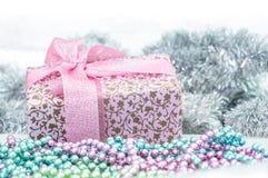Gift box with ribbon near xmas decoration Royalty Free Stock Image