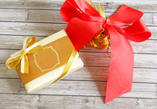 Gift box and ribbon over wooden background Royalty Free Stock Photo