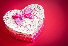 Gift box with ribbon on red background,concept of valentine day Royalty Free Stock Image