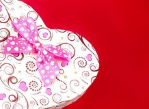 Gift box with ribbon on red background,concept of valentine day Royalty Free Stock Images