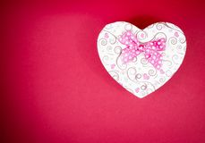 Gift box with ribbon on red background,concept of valentine day Stock Images