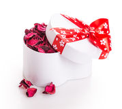 Gift box ribbon red heart with flower petals Royalty Free Stock Photography