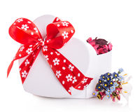 Gift box ribbon red heart with flower petals Stock Image