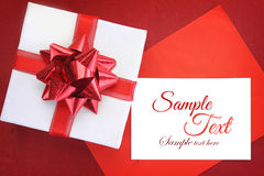 Gift box with ribbon & white card Stock Image