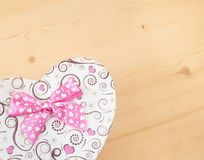 Gift box with ribbon on wood table, concept of valentine day Royalty Free Stock Photography