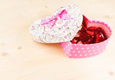 Gift box with ribbon on wood table, concept of valentine day Royalty Free Stock Photos