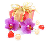 Gift box with ribbons and orchid Royalty Free Stock Images