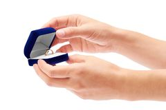 Gift box with ring in hand isolated on white background.  Stock Photo