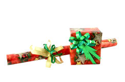 Gift box with roll of paper. On white background Stock Photography