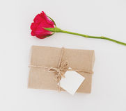 Gift box with rose flower with blank white card, for valentines gift, on white background Stock Images