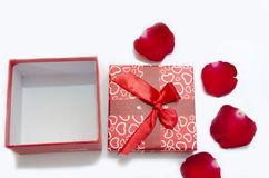 Gift box and rose. Flower white background Royalty Free Stock Images