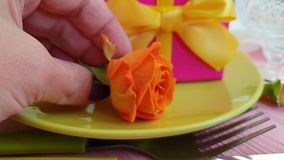 Gift box, rose , plate, slow motion elegant surprise. Gift box rose plate slow motion elegant surprise
