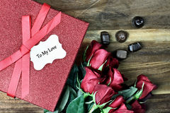 Gift Box with Roses and Chocolate Royalty Free Stock Photography