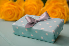 Gift box and roses with a Valentines, wedding, anniversary, Mothers Day or birthday gift.  Stock Image