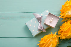Gift box and roses with a Valentines, wedding, anniversary, Mothers Day or birthday gift.  Stock Images