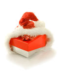 Gift box in santa hat,isolated Stock Photography
