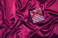 Gift box on satin background Royalty Free Stock Photography