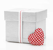 Gift box with satin ribbon with heart Royalty Free Stock Image