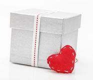 Gift box with satin ribbon with heart Stock Image